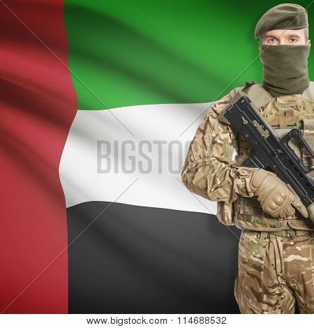 Soldier Holding Machine Gun With Flag On Background Series - United Arab Emirates