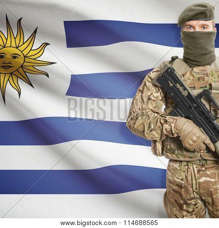 Soldier Holding Machine Gun With Flag On Background Series - Uruguay