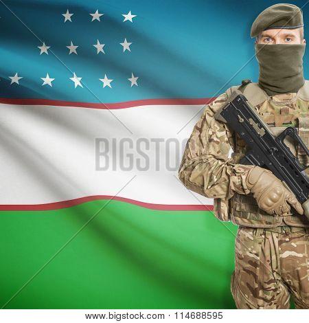Soldier Holding Machine Gun With Flag On Background Series - Uzbekistan