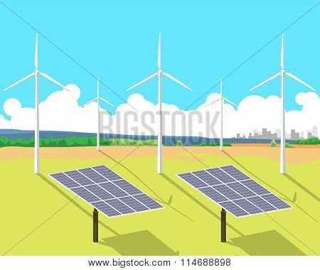 View of solar panels and wind turbines standing in a field against the sky and the city on the horiz