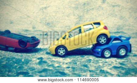 Blur Of Crashed Toy Cars (vintage Effect)