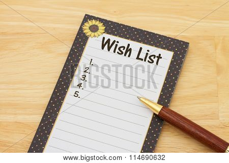 A Notepad And Pen On A Desk With Text Wish List And Copy-space