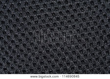 Black fabric texture with pattern, with sagging inside the ovals. The texture of the fabric. Closeup