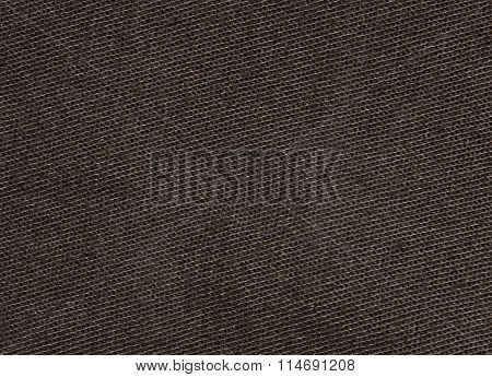 Brown jeans texture with diagonal stripes, hair and lint. Closeup
