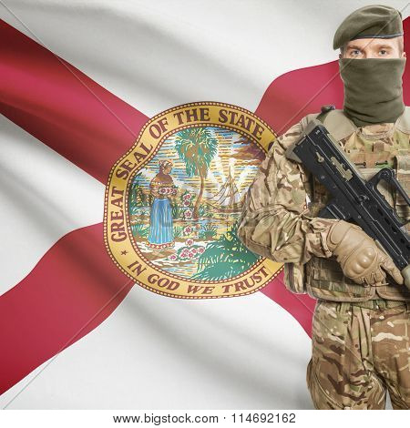 Soldier Holding Machine Gun With Usa State Flag On Background Series - Florida