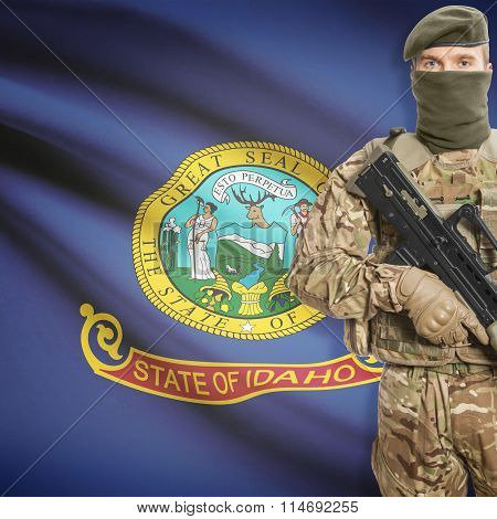 Soldier Holding Machine Gun With Usa State Flag On Background Series - Idaho