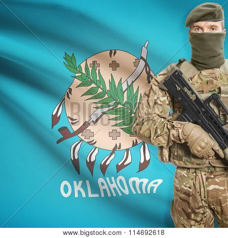 Soldier Holding Machine Gun With Usa State Flag On Background Series - Oklahoma