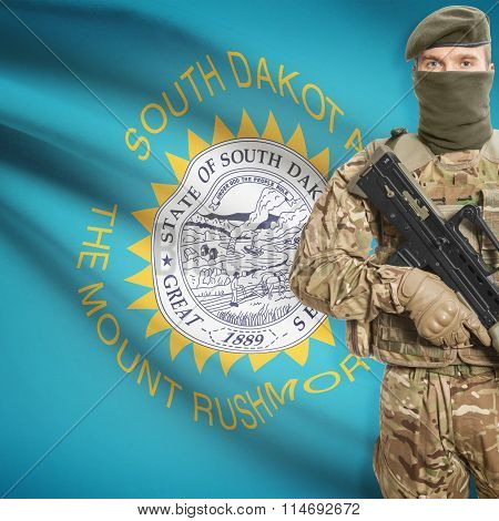 Soldier Holding Machine Gun With Usa State Flag On Background Series - South Dakota
