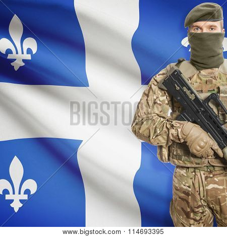 Soldier Holding Machine Gun With Canadian Province Flag On Background Series - Quebec