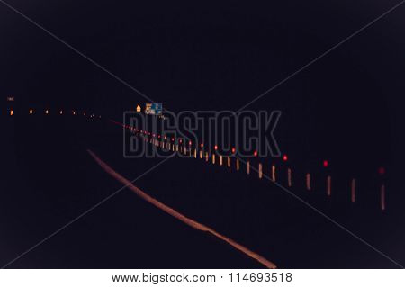 Night Road track and Cars headlights with rainy window Background Blurred Travel concept