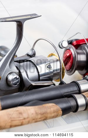 Fishing Rod With Reel On Background Of Tackles In Boxes