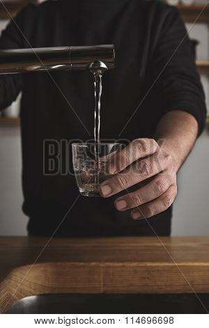 Barista Fills Small Glass With Water