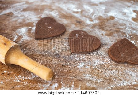 Heart Shaped Cookies And Rolling Pin On Wooden Table.