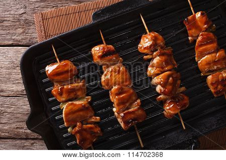 Yakitori Skewers Of Chicken On A Grill Pan Close-up. Horizontal Top View