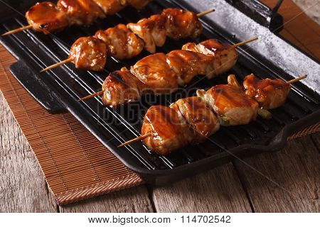 Delicious Japanese Yakitori Barbecue Of Chicken On A Grill Pan.