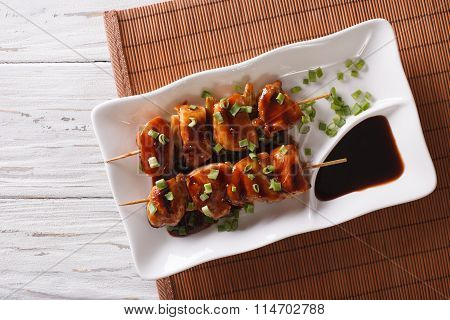 Yakitori Chicken With Green Onions On A Plate. Horizontal Top View