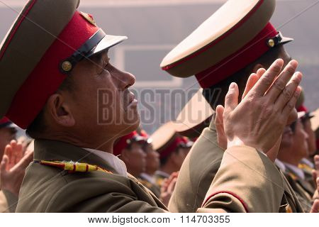 Pyongyang, North Korea. April 2012: North Korea army officer cheering for new leader Kim Jong-Un at the military parade in Pyongyang. Celebrating the centenary of birth of President Kim Il Sung