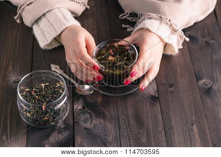 Woman Holding Hot Cup Of Black Tea