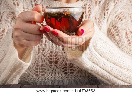 Female In White Openwork Pullover Hold Cup Of Tea