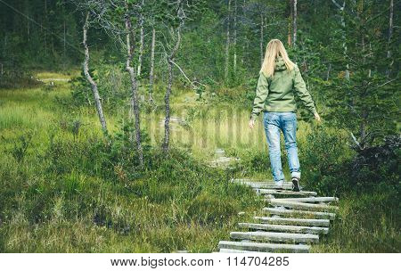 Young Woman walking in forest wooden road alone outdoor