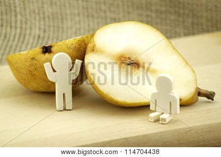 Pear decorated with two wooden males