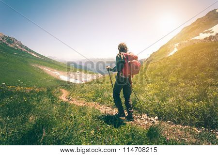 Young Man with backpack mountaineering outdoor Travel Lifestyle concept