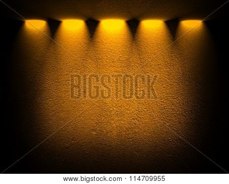 yellow concrete wall with spotlights