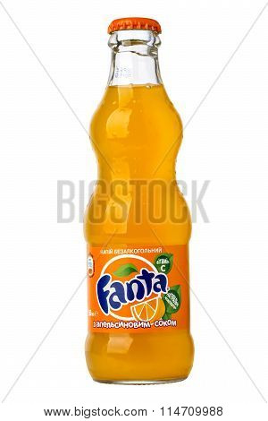 CHISINAU MOLDOVA-- November 14 2015: Fanta glass bottle on white background. Fanta is popular fruit-flavored carbonated soft drink created by Coca-Cola company.