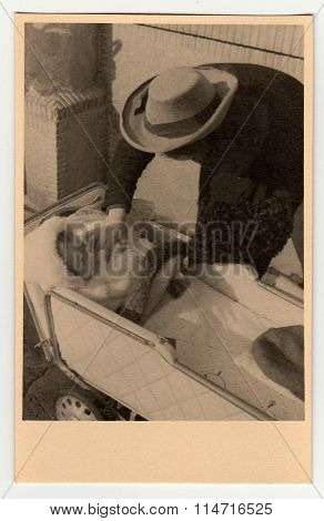 Father with baby girl in the pram (baby carriage) - vintage photo