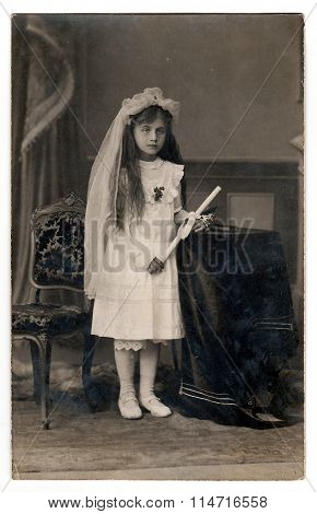 Vintage photo of a young girl - her first holy