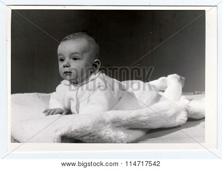 Retro photo of baby boy (six months old). Portrait photo was taken in photo studio