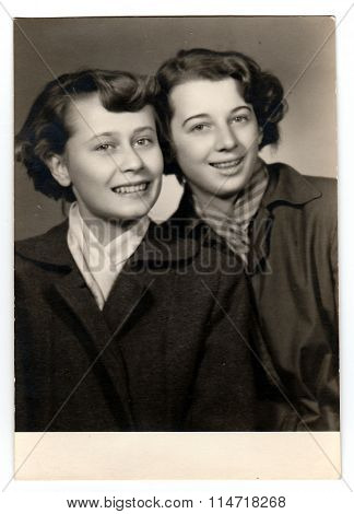 A vintage studio photo portrait shows two women