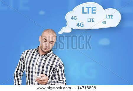 Handsome man thinking about mobile internet connection
