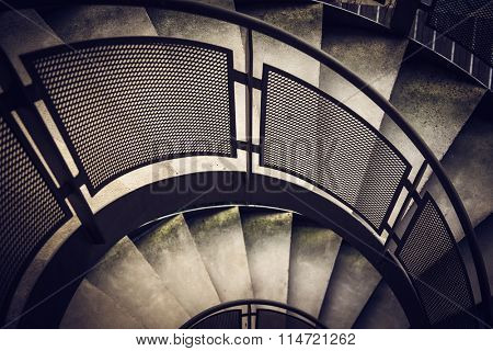 Modern spiral staircase with metallic hand-rails. LOMO effect