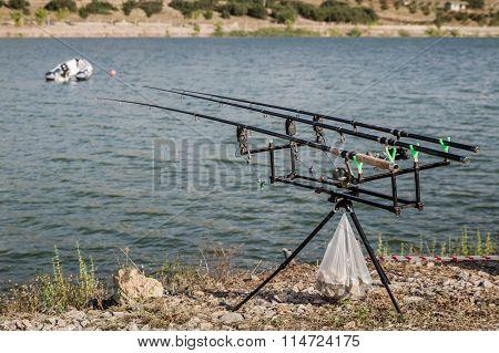 Reels On Fishing Rods Near Lake