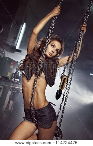 Beautiful girl with crane chains