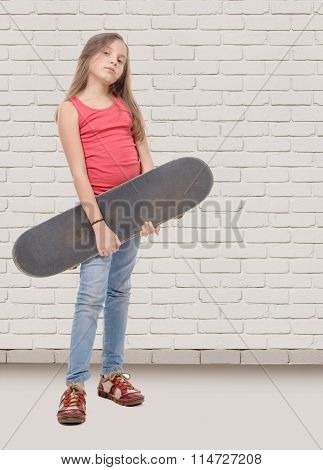 Pretty Little Girl With Skateboard, White Brick Wall Background