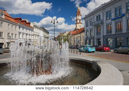 View to the historical buildings and fountain at the central part of Vilnius city, Lithuania.