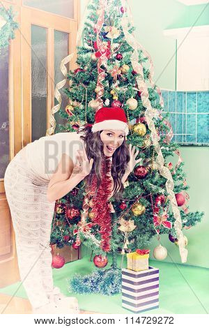 Happy Young Woman With Gifts Rejoicing Ahead Of Christmas Tree