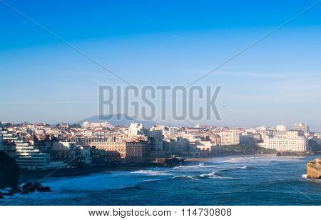 ocean and city, blue sky