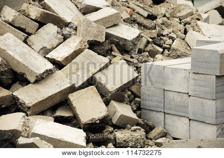 piles of damaged bricks in construction site
