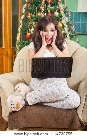 Thrilled Young Woman Using Laptop Computer With Excitement