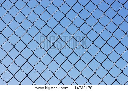 iron chain link fence background against sky