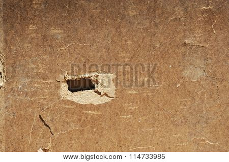 damaged cardboard with hole on it