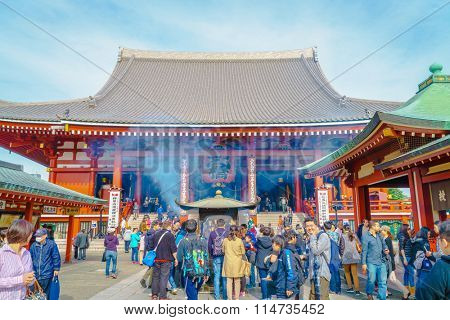 TOKYO, JAPAN - November  24, 2015: Tourists visit to Sensoji Temple  of Asakusa, Tokyo, Japan. The temple is the oldest in all of Tokyo