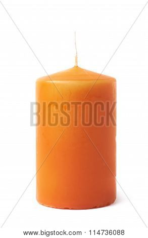 Single orange wax candle isolated
