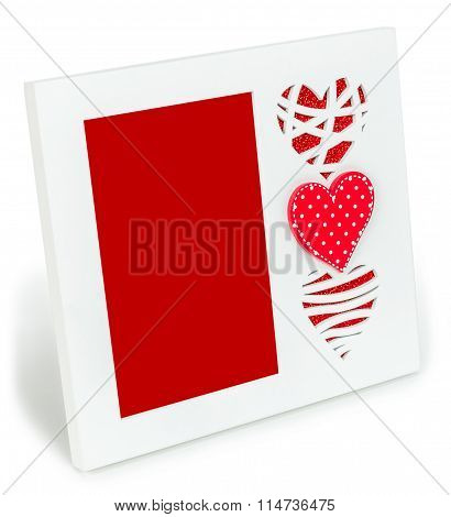 White photo frame with red hearts  on isolaed  background