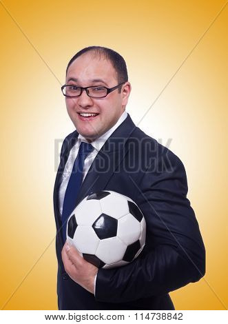 Businessman with football against the gradient