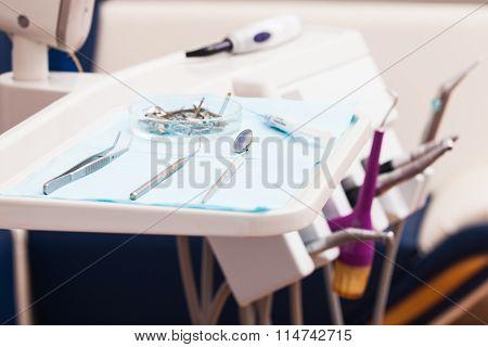 Dental instruments probe, tweezer, syringe and dental mirror for test the oral cavity