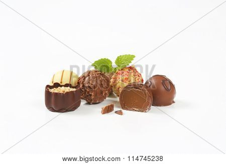 assorted belgian chocolate pralines on white background